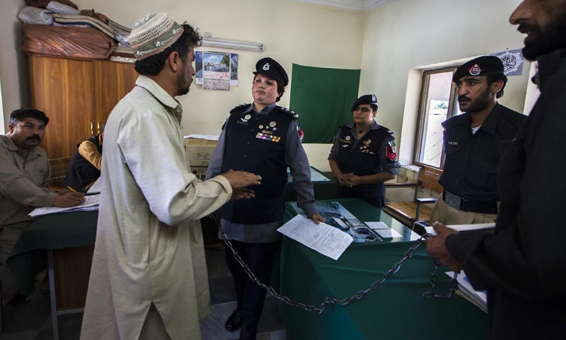 Pakistani Police Inspector Shazadi Gillani (C) interrogates an accused kidnapper at a police station in Abbottabad September 18, 2013. — Photo by Reuters