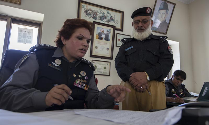 Pakistani Police Inspector Shazadi Gillani (L) talks to a member of her team at a police station in Abbottabad September 18, 2013. — Photo by Reuters