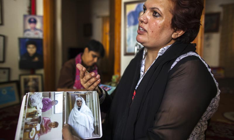 Pakistani Police Inspector Shazadi Gillani shows a photo of herself wearing a burqa, at her house in Abbottabad September 18, 2013.— Photo by Reuters