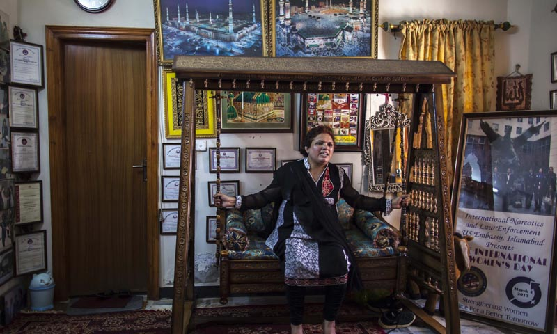 Pakistani Police Inspector Shazadi Gillani reacts as she sits on a wooden swing during an interview with Reuters at her house in Abbottabad September 18, 2013. — Photo by Reuters