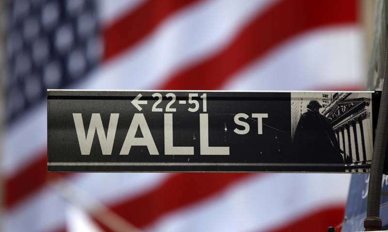 The Wall Street sign is seen near the New York Stock Exchange. — Reuters Photo