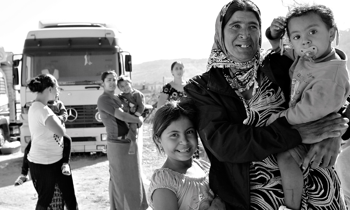 A gypsy woman holding her child poses for photos  at a gypsy camp near the town of Farsala, some 280 km ( 173 miles) north of Athens, Greece. Greek authorities on Friday, Oct. 18, 2013 have requested international assistance to identify the four-year-old girl found living in a Gypsy camp with a couple arrested and charged with abducting her from her birth parents.  - AP Photo