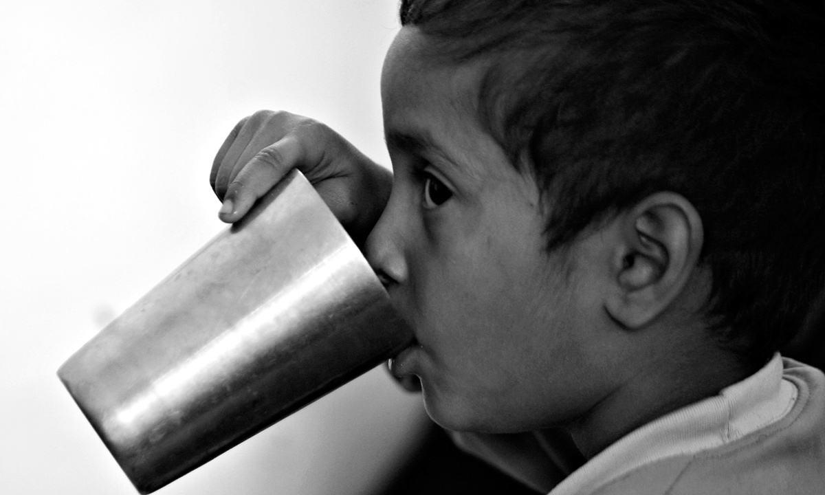 An Indian boy who fled from his home in Suchetgarh Kullian village, near the India Pakistan border drinks water after arriving at a community center at Samba, about 48 kilometers (30 miles) south of Jammu, India. According to Indian news reports hundreds of Indian villagers including women and children from the border village left their homes Saturday night and took shelter here following shelling from the Pakistan side. - AP Photo