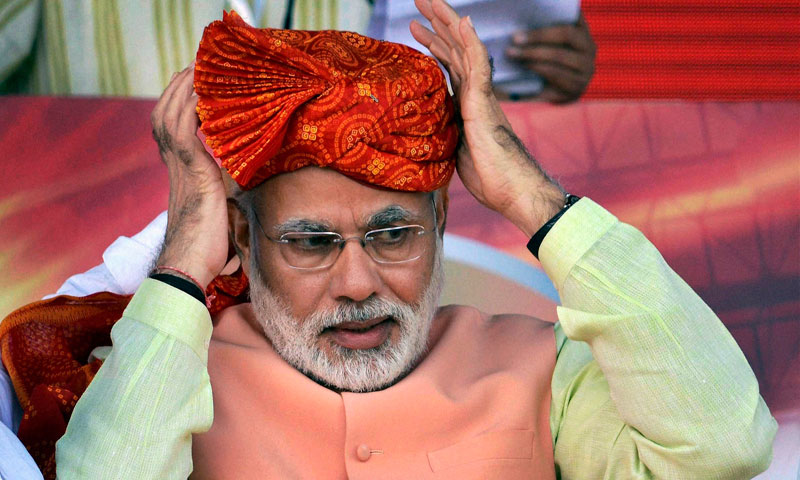 India's main opposition Bharatiya Janata Party (BJP)'s prime ministerial candidate Narendra Modi sports a turban he was presented with at a rally in Patna, India, Sunday, Oct. 27, 2013. - Photo by AP