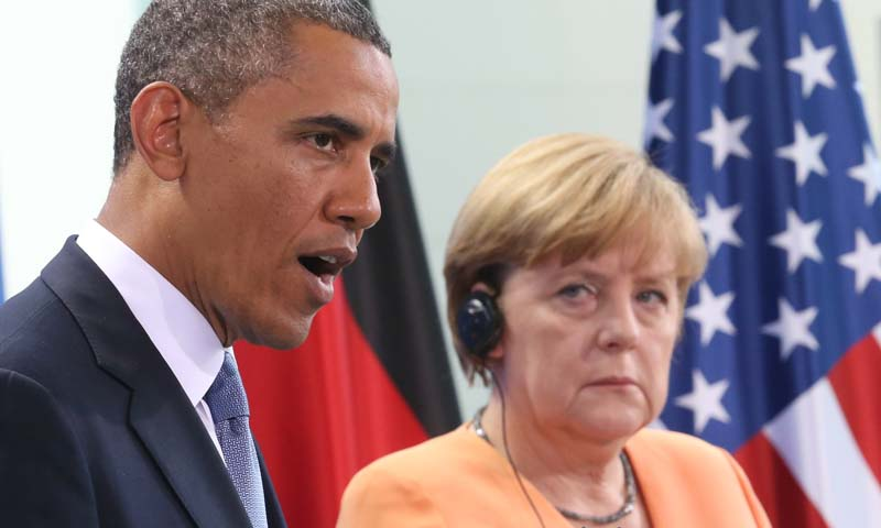 US President Barack Obama speaks  during a  press conference with German Chancellor Angela Merkel, right, at the  Chancellery in Berlin on June 19, 2013. — Photo AP