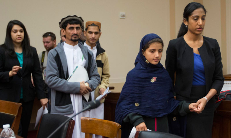 Pakistani Nabila Rehman (2nd R), 9, is escorted by unidentified legal representation to a news conference with her father Rafiq (4th R) and brother Zubair (3rd R) on Capitol Hill in Washington, October 29, 2013. – Reuters Photo