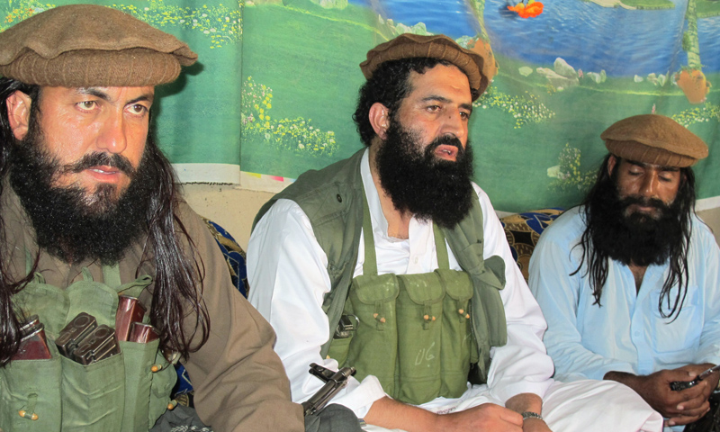 In this Oct 5, 2013 photo, Pakistani Taliban spokesman Shahidullah Shahid (centre) speaks in an interview at an undisclosed location in Pakistan's tribal areas.—AP Photo