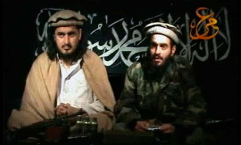 Taliban leader Hakimullah Mehsud (L) sits beside a man who is believed to be Humam Khalil Abu-Mulal Al-Balawi, the suicide bomber who killed CIA agents in Afghanistan. — Reuters Photo