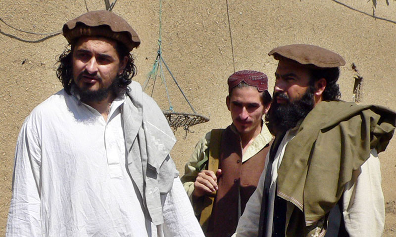 This photograph taken on October 4, 2009 shows then new Pakistani Taliban chief Hakimullah Mehsud (L) arriving with his commander Wali-ur Rehman (R) for a meeting with local media representatives in South Waziristan. – AFP