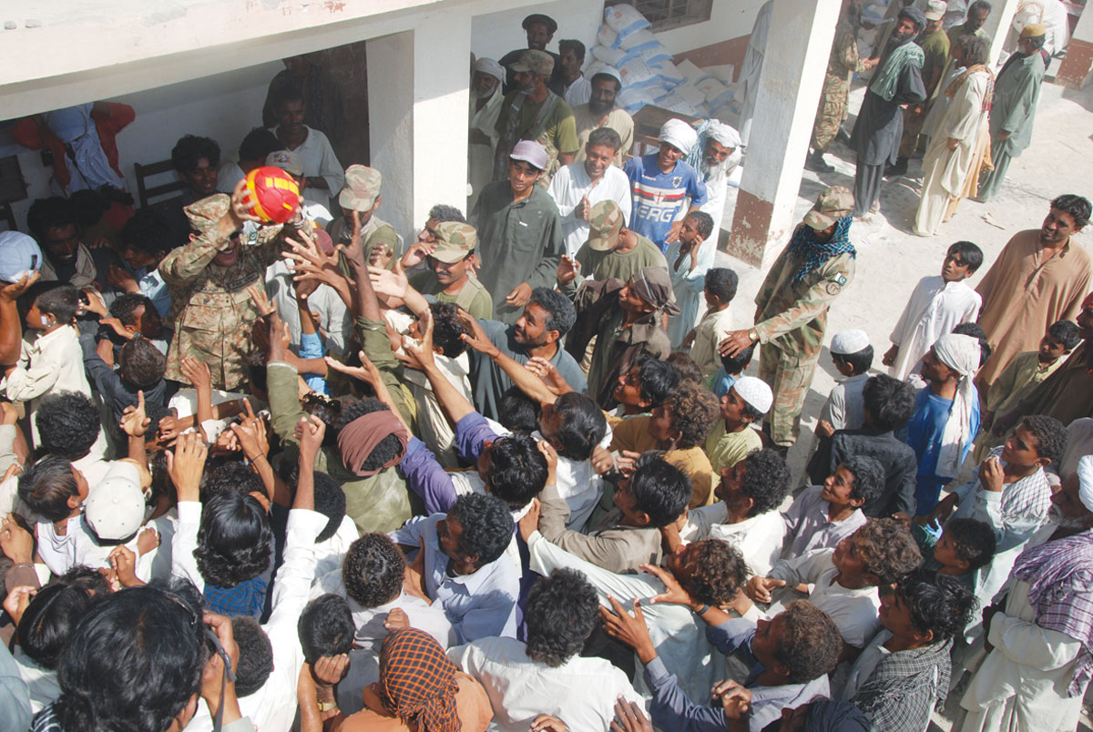 People gather to get relief goods.-Photos by ISPR and White Star