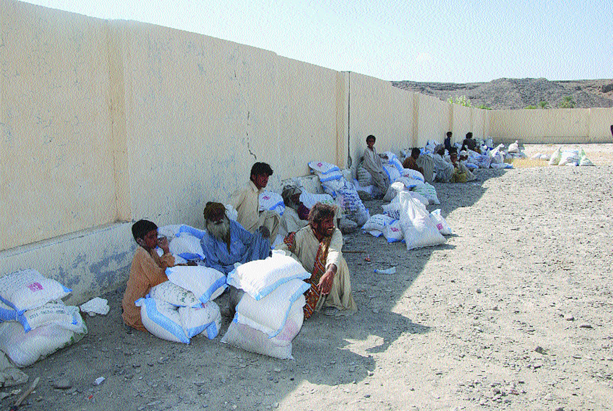 Bulk supplies of staple food.-Photos by ISPR and White Star