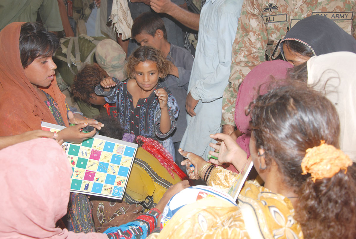 Sharing shelter and stories in a relief camp.-Photos by ISPR and White Star