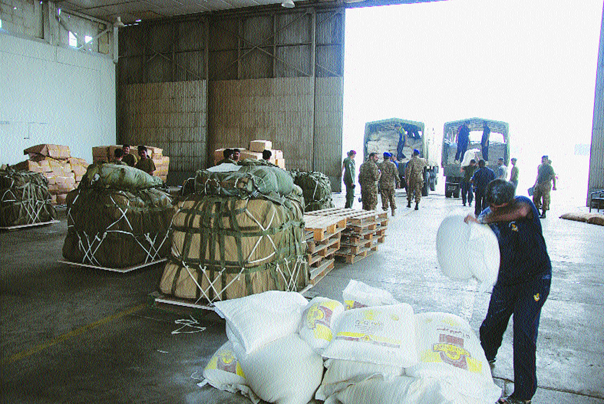 Food and other relief supplies for the quake victims.-Photos by ISPR and White Star