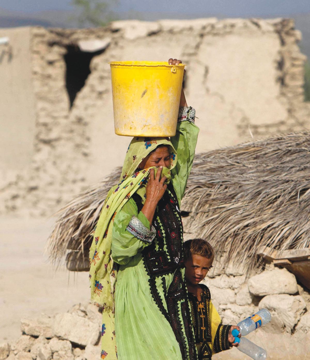 Dozens of natural springs, the only potable water source for local residents, disappeared after the quake, creating an acute water shortage.-Photos by ISPR and White Star