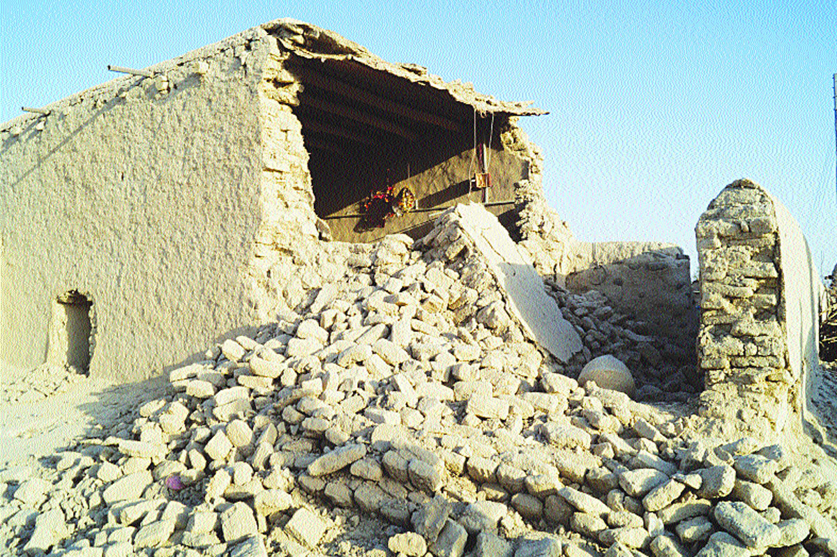 Scores of mud built houses were destroyed in the 7.7 magnitude quake.-Photos by ISPR and White Star