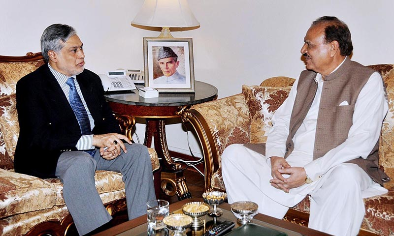 Federal Minister for Finance, Senator Mohammad Ishaq Dar called on President Mamnoon Hussain. — Photo by APP