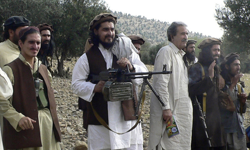 In this file image taken on Oct 4, 2009, Pakistani Taliban leader Hakimullah Mehsud, centre, operates light machine gun with his comrades in Sararogha in the Pakistani tribal area of South Waziristan along the Afghanistan border. — Photo by AP