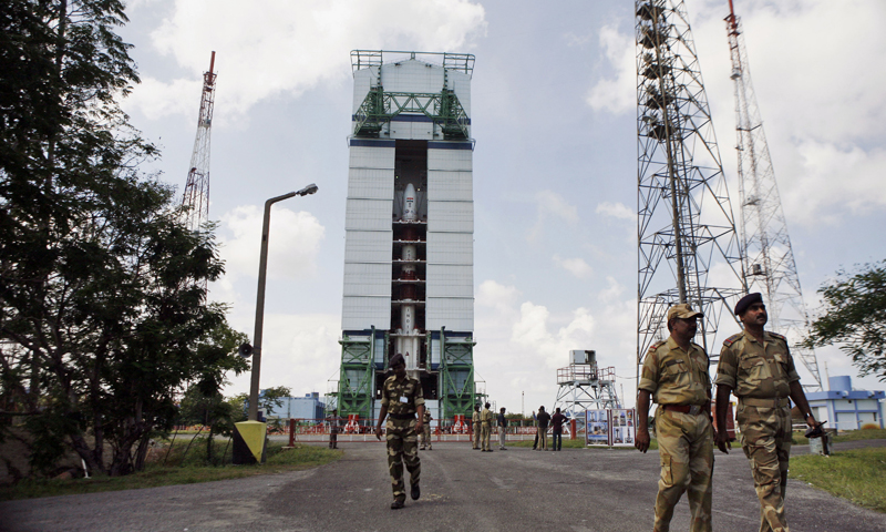Oct 30 photo shows Central Industrial Security Force (CISF) personnel walking near the Polar Satellite Launch Vehicle (PSLV – C25) at the Satish Dhawan Space Center at Sriharikota, in the southern Indian state of Andhra Pradesh.— Photo by AP