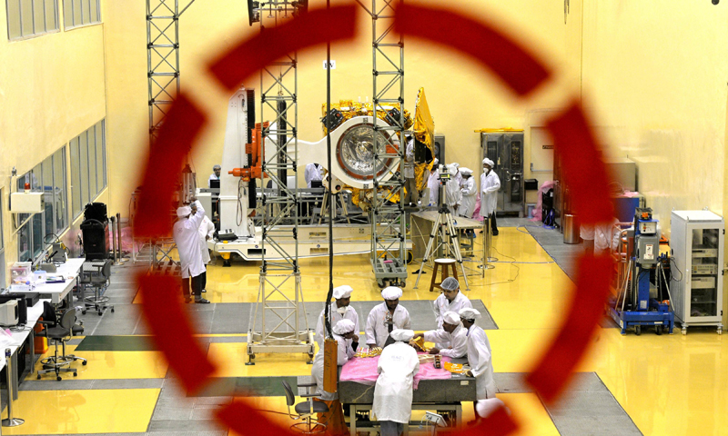 In this file picture taken on September 11, 2013, scientists and engineers work on a Mars Orbiter vehicle at the Indian Space Research Organisation's (ISRO) satellite centre in Bangalore. —Photo by AFP