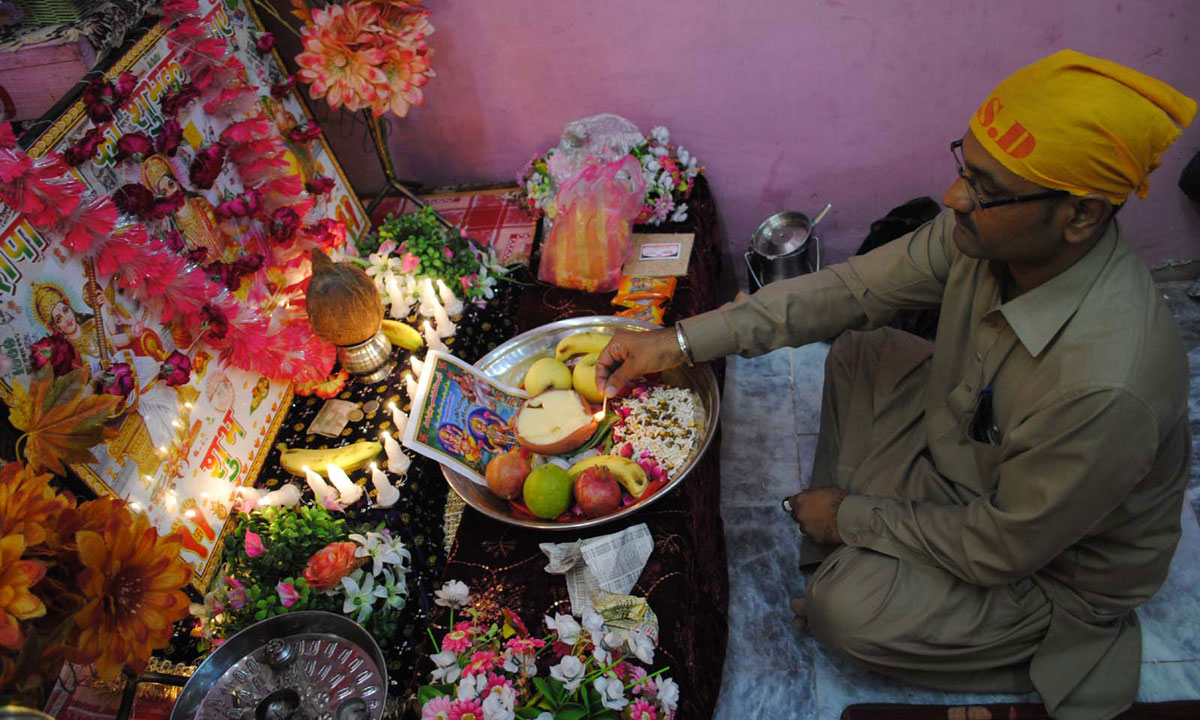 A member of the Hindu community in Hyderabad performs a religious ritual in honor of Dewali. – Photo by INP