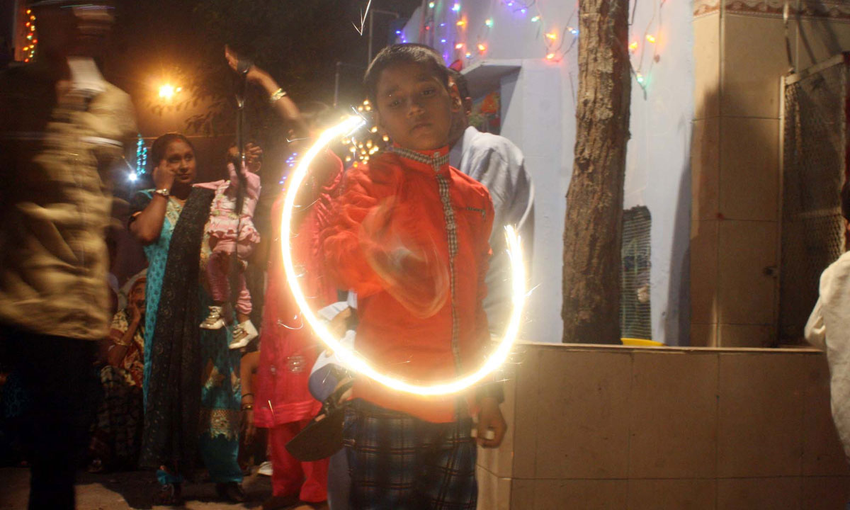A Hindu child plays with sparklers during Diwali celebrations, held near Swami Narayan Temple in Karachi. – Photo by PPI
