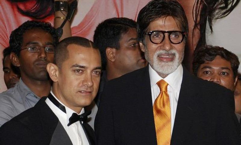 Aamir Khan, left, and Amitabh Bacchan, right, at a movie premier in Mumbai, India. — Courtesy Photo