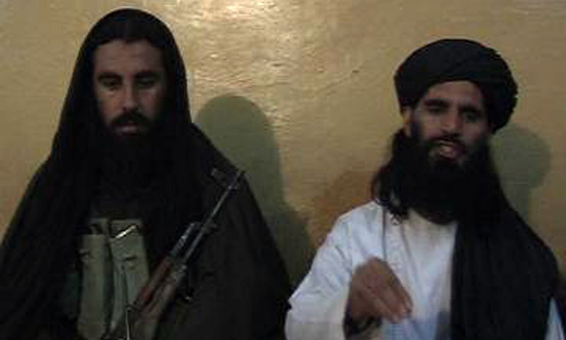 This video grab taken on November 7, 2013, shows Asmatullah Shaheen (R) caretaker chief Tehrik-i-Taliban Pakistan (TTP) announcing the new leader of TTP during a press conference in an undisclosed location in northwest Pakistan. – AFP