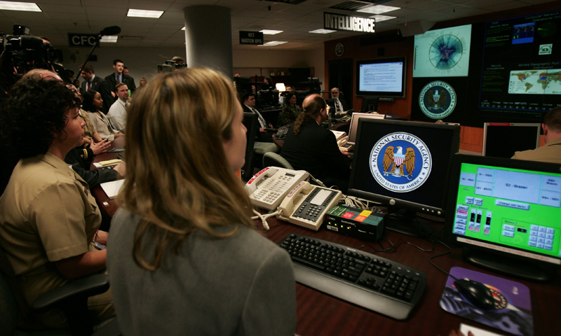 Picture taken on January 25, 2006 shows experts working at the Threat Operations Center inside the National Security Agency (NSA) in suburban Fort Mead, Maryland. — AFP Photo