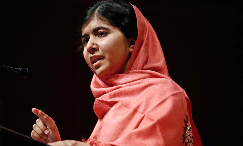 In this Friday, Sept. 27, 2013 file photo, Malala Yousafzai addresses students and faculty after receiving the 2013 Peter J. Gomes Humanitarian Award at Harvard University in Cambridge, Mass. -AP Photo
