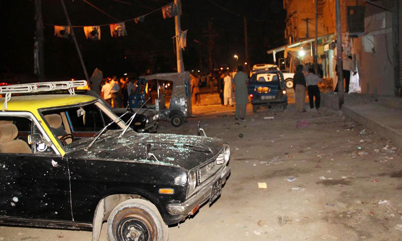 A cab seen standing at the site of twin bomb blasts outside an Imambargah near Pahar Ganj area in Karachi's North Nazimabad on Wednesday. – Photo by Online