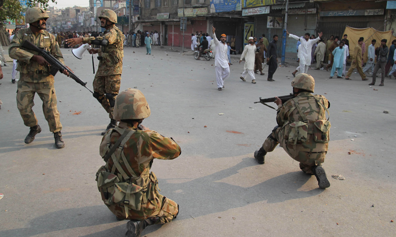Army soldiers take position to disperse protesters in Multan on November 16, 2013.—AFP Photo