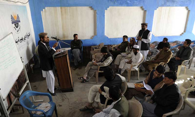 In this picture taken on Nov 1, 2013, Afghan Pashto poets gather as they read their poems at a cultural organisation in Jalalabad. — AFP