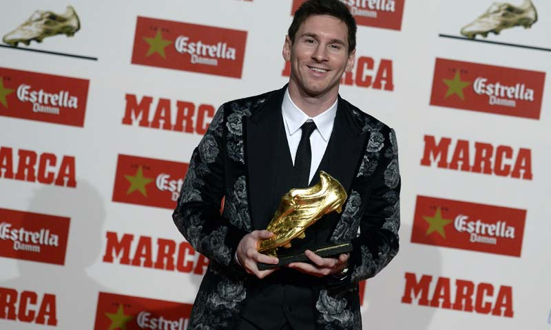 Barcelona's Argentinian forward Lionel Messi poses after receiving his Golden Boot 2013 award, presented to Europe's best goal scorer of the 2012-2013 season in Barcelona. -AFP Photo