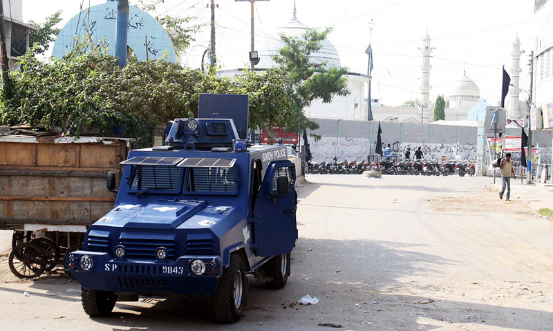 Police armoured vehicle parked outside imambargah in Karachi.—Online Photo