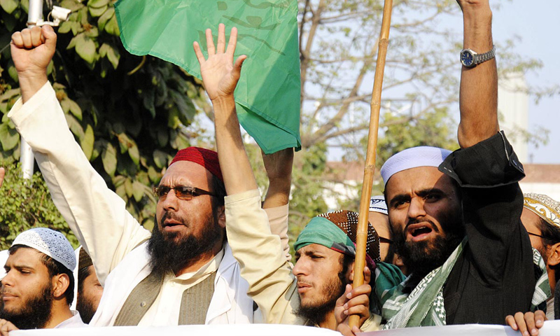 Activists of different religious parties hold a demonstration outside the Lahore Press Club.—Online Photo