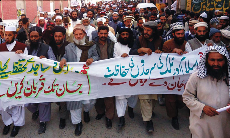 Activists of different religious parties hold a demonstration in Rawalakot.—Online Photo