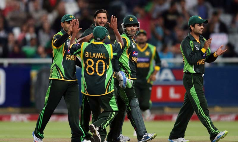 Pakistan's players celebrate the wicket of South Africa's Quinton de Kock during the second T20 International Cricket Match between Pakistan and South Africa at the Sahara Park Newlands Cricket Ground in Cape Town. -AFP Photo