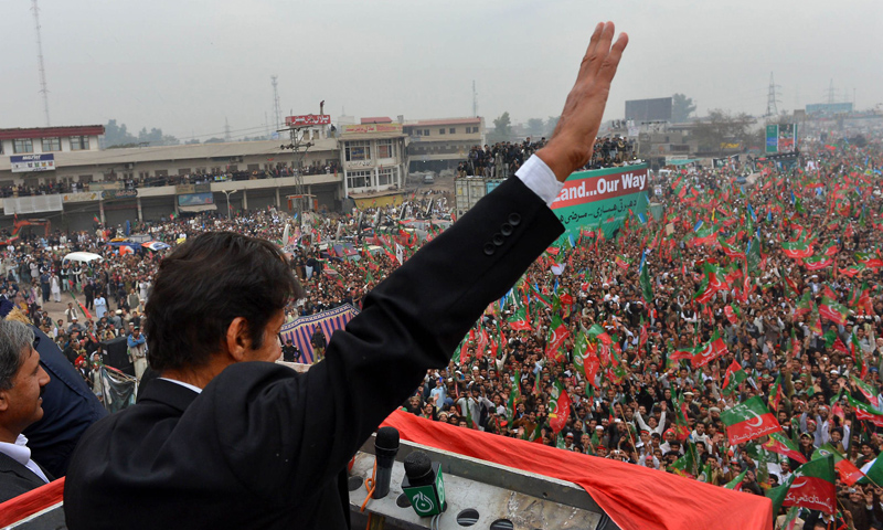 Imran Khan, Chairman of Pakistan Tehrik-i-Insaf (PTI), gestures while addressing a protest rally in Peshawar on November 23, 2013.—AFP Photo
