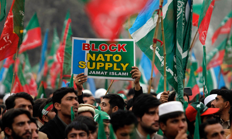 Supporters of the Pakistan Tehrik-i-Insaf (PTI) protest during a rally to stop Nato supply routes into Afghanistan and drone attacks, in Peshawar November 23, 2013.—Reuters Photo