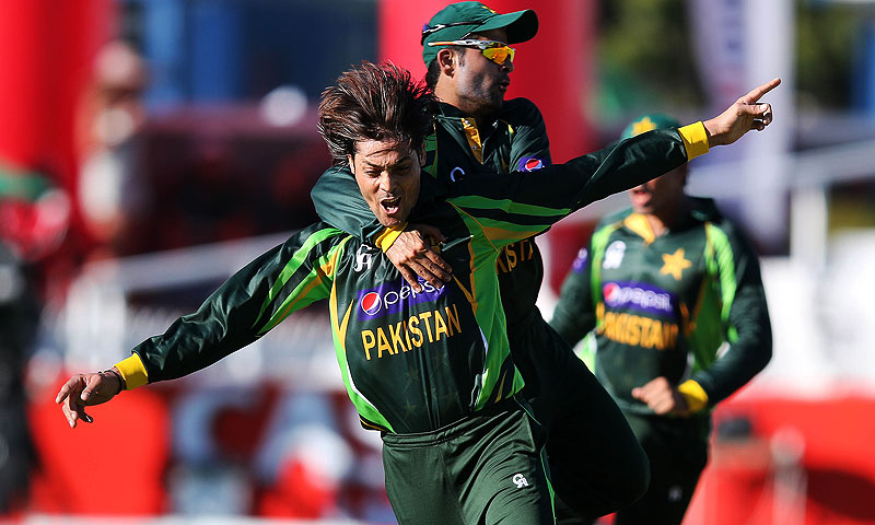 Anwar Ali and Ahmed Shahzad ( back) celebrate the wicket of South Africa's  David Miller. -Photo by AFP