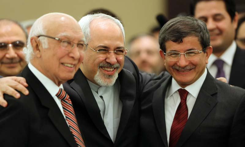 Iranian Foreign Minister Mohammad Javad Zarif (C) poses for a picture with his counterparts from Pakistan, Sartaj Aziz (L), and Turkey, Ahmet Davutoglu, during the opening session of a two-day ministerial conference of the Economic Cooperation Organisation (ECO), which groups 10 Asian and Eurasian countries, in Tehran. -AFP Photo