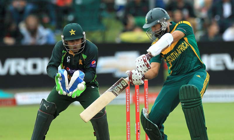 South Africa's batsman Hashim Amla, right, plays a shot as Pakistan's wicketkeeper Umar Akmal fields during the 2nd One Day International cricket match at St George's Park, Port Elizabeth, South Africa. -AP Photo