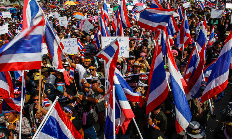 Thousands of anti-government protesters gather  in Bangkok Nov 30, 2013. Police tightened security in Thailand's capital on Saturday as thousands of protesters rallied outside a state telecommunications group and vowed to occupy Prime Minister Yingluck Shinawatra's office to paralyse her administration. — Photo by Reuters