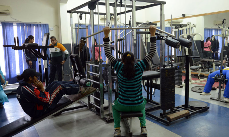 Members of the Pakistan women's Kabaddi team exercise at a gym in Lahore. —Photo by AFP