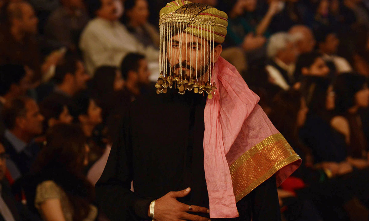 A Pakistani model presents a creation by designer Fahad Hussayn. – Photo by