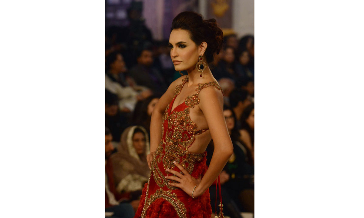 A Pakistani model presents a creation by designer Ammar Shahid. – Photo by AFP