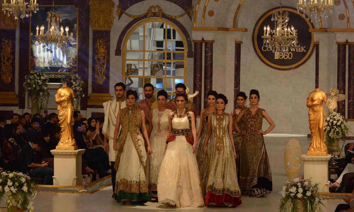 Pakistani models present creations by designer Ammar Shahid. – Photo by AFP