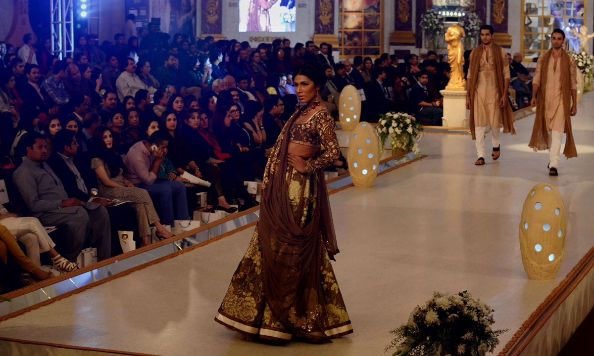 Pakistani models present creations by designer Fahad Hussayn. – Photo by AFP