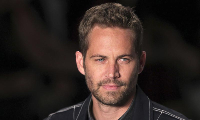 """US actor Paul Walker presents a creation from Colcci's 2013/2014 summer collection during Sao Paulo Fashion Week in this March 21, 2013 file photo. Walker, of the film series """"The Fast and The Furious"""" is reported to have died in aN auto accident according to local media reports. — Photo by Reuters"""