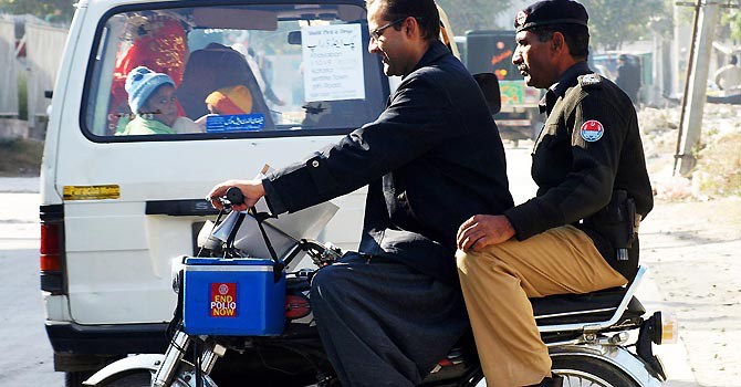 Policeman killed in attack on polio team